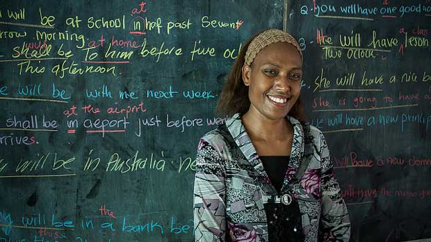 """Grade 11 teacher Annette teaches English to her students"" by Department of Foreign Affairs and Trade licensed under CC BY 2.0"