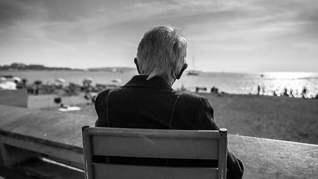 """Old man watching the beach"" by Franck Michel licensed under CC BY 2.0"