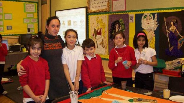 """Myriam teaching at Davies Lane Primary School"" by spiraltri3e licensed under CC BY 2.0"