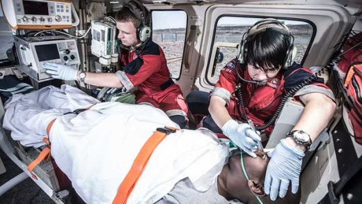"""""""Paramedics and patient inside medical helicopter"""" by ER24 EMS (Pty) Ltd licensed under CC BY 2.0"""