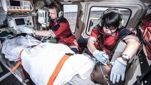 """Paramedics and patient inside medical helicopter"" by ER24 EMS (Pty) Ltd licensed under CC BY 2.0"