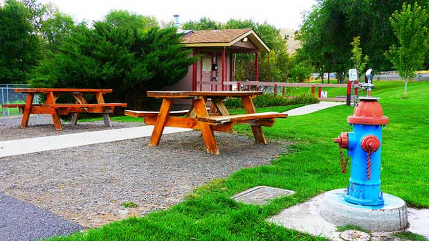"""""""Picnic Tables & Drinking Fountain in Dayville, Oregon"""" by Rick Obst licensed under CC BY 2.0"""