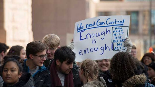 """High school students protest for gun reform"" by Fibonacci Blue licensed under CC BY 2.0"