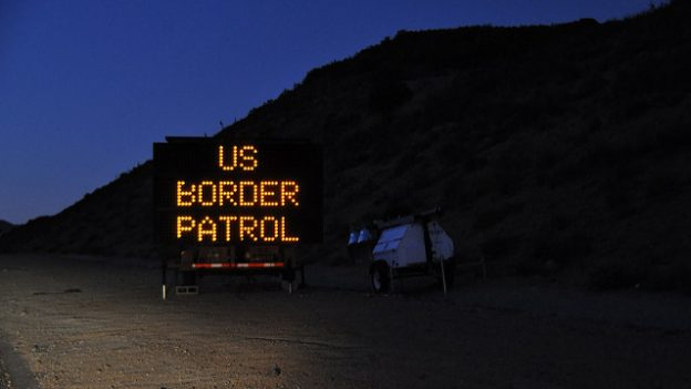 """US Checkpoint Sign"" by Jonathan McIntosh licensed under CC BY 2.0"