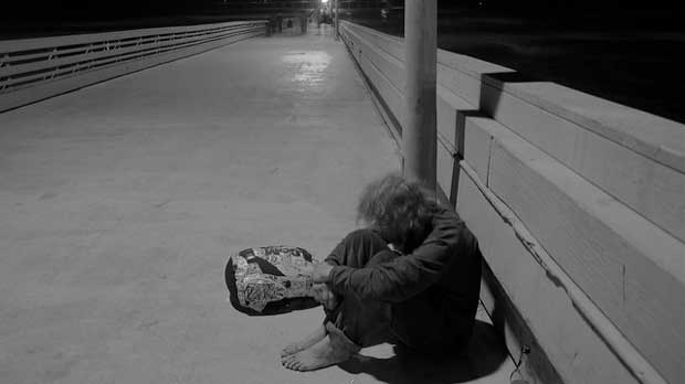 """""""Homeless in Ocean Beach"""" by The Angry Photographer of Education licensed under CC BY 2.0"""