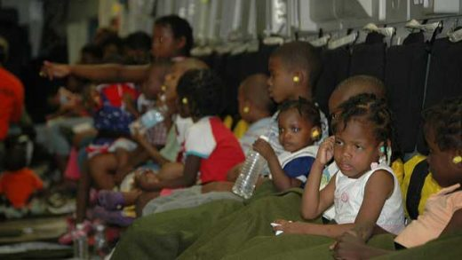 """""""Orphans Leave Haiti"""" by DVIDSHUB licensed under CC BY 2.0"""