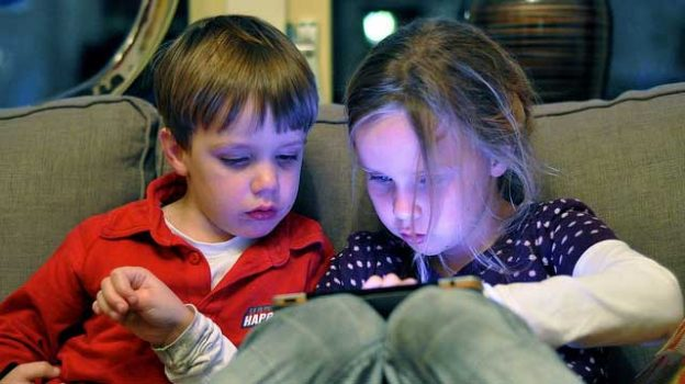 """""""Kids on the iPad"""" by Thijs Knaap licensed under CC BY 2.0"""