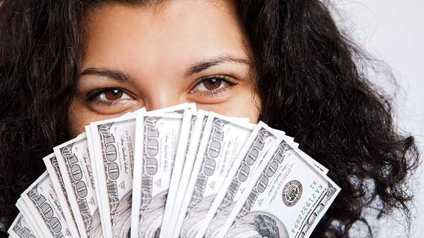 """""""Money Girl"""" by Tax Credits licensed under CC BY 2.0"""