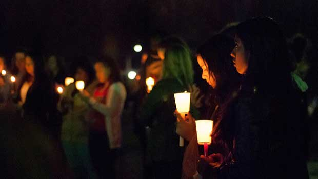 """people at vigil 2"" by Mark Zastrow licensed under CC BY 2.0"