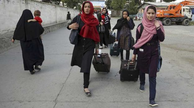 Members of a female robotics team arrive from Herat province to receive visas from the  U.S. embassy, at the Hamid Karzai International Airport, in Kabul, Afghanistan, Thursday, July 13, 2017. The girls' applications for U.S. visas had been denied twice, but the White House said President Donald Trump intervened and they will be allowed in next week's international competition along with entrants from 157 countries. (AP Photo/Rahmat Gul)