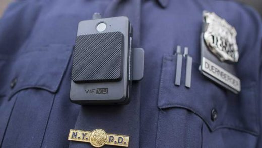 FILE - In this April 27, 2017, file photo, a police officer wears a newly-issued body camera, part of the first phase of a plan to equip 22,000 officers with body cameras, outside the 34th precinct in New York. Seattle Mayor Ed Murray on Monday, July 17, 2017, ordered the city's police department to equip patrol officers with body cameras, saying he doesn't want any other serious uses of force to go unrecorded. The decision came a month after the absence of video recordings left lingering questions about the police shooting of Charleena Lyles, a pregnant mother who had struggled with mental health issues. (AP Photo/Mary Altaffer, File)
