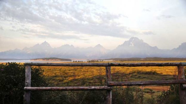 FILE - In this Aug. 26, 2016 file photo, the morning sun illuminates the Grand Tetons in Grand Teton National Park, north of Jackson Hole, Wyo. Grand Teton National Park, normally in the shadow of the neighboring and world-renowned Yellowstone National Park in northwest Wyoming, is set to get its day in the sun with next week's total solar eclipse passing directly over the park. (AP Photo/Brennan Linsley, File)