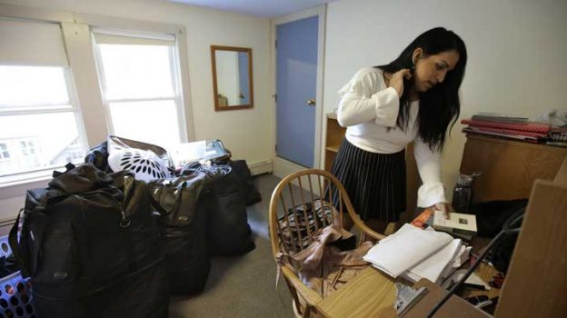 In this Wednesday, Aug. 30, 2017 photo Ninotska Love, who has been accepted at Wellesley College, unpacks in her dorm room at the women's school, in Wellesley, Mass. Until last year, Love would have been barred from attending Wellesley. She's an accomplished student who has persevered through hardship, but under longstanding rules, the college would have rejected her because she was assigned at birth as a boy. Now the rules have changed. Love will become one of the first transgender women to attend Wellesley in the school's 147-year history. (AP Photo/Steven Senne)