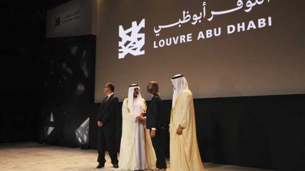 Officials gather after an announcement about the opening of the Louvre Abu Dhabi in Abu Dhabi, United Arab Emirates, Wednesday, Sept. 6, 2017. Officials on Wednesday announced that the Louvre Abu Dhabi, a Mideast outpost of the famed French museum, will open Nov. 11. (AP Photo/Jon Gambrell)