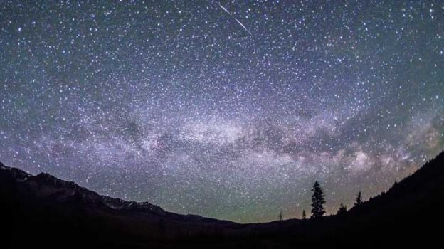 This June 4, 2016 photo provided by Nils Ribi Photography shows the Milky Way in the night sky at the foot of the Boulder Mountains in the Sawtooth National Recreation Area, Idaho. Tourists heading to central Idaho will be in the dark if local officials get their way. The nation's first International Dark Sky Reserve will fill a chunk of the sparsely populated region containing night skies so pristine that interstellar dust clouds are visible in the Milky Way. (Nils Ribi Photography via AP)