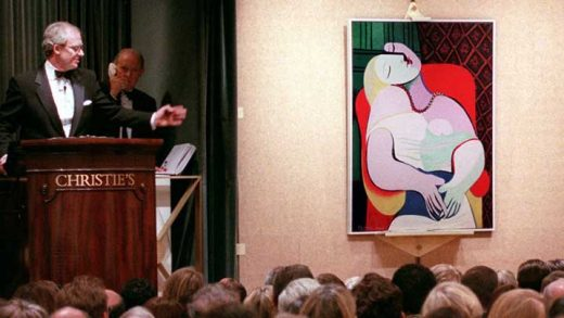 "FILE - In this Nov. 10, 1997 file photo, Picasso's ""The Dream"" is auctioned by auctioneer Christopher Burge at Christie's auction house in New York. An exhibition in Paris and London will reunite three Picasso nudes painted days apart but not displayed together for almost a century, the Tate Modern gallery said Thursday, Sept. 21, 2017.  (AP Photo/Emile Wamsteker, file)"