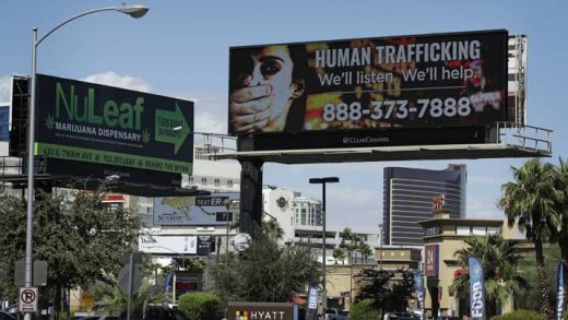 A billboard displays a phone number for the National Human Trafficking Hotline, Thursday, Sept. 21, 2017, in Las Vegas. The FBI in Las Vegas is teaming with a billboard company to raise the profile in the fight to stop human trafficking in a state where brothels are legal in rural counties, but prostitution is illegal in cities like Las Vegas and Reno. (AP Photo/John Locher)