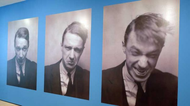 In this photo taken Sept. 27, 2017, self portraits of Walker Evans taken in a photo booth in 1929 are displayed on a wall in a retrospective exhibition of his work at the San Francisco Museum of Modern Art in San Francisco. The exhibit highlights the vernacular work of Evans, one of the preeminent photographers of the 20th century. The display, which includes 400 photos, paintings and objects, runs through Feb. 4, 2018. (AP Photo/Eric Risberg)