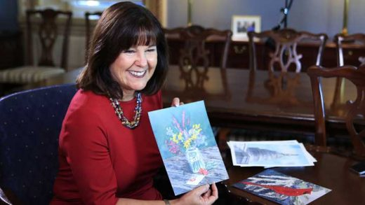 "Karen Pence, wife of Vice President Mike Pence, shows her artwork during an interview with The Associated Press in her office at the Eisenhower Executive Office Building on the White House complex in Washington, Tuesday, Oct. 17, 2017. Pence is using her platform as the vice president's wife to raise awareness about art therapy, a mental health field she's been passionate about for a decade but says is unknown to many. ""I don't think that a lot of people understand the difference between therapeutic art and art therapy,"" Mrs. Pence, a trained watercolor artist, told The AP in an exclusive interview before she visits Florida on Wednesday to outline her vision for her art therapy initiative. (AP Photo/Manuel Balce Ceneta)"