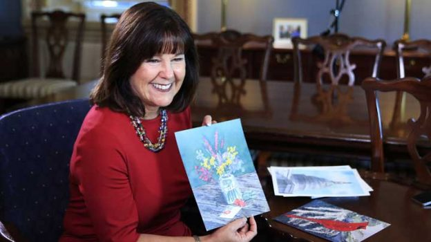 """Karen Pence, wife of Vice President Mike Pence, shows her artwork during an interview with The Associated Press in her office at the Eisenhower Executive Office Building on the White House complex in Washington, Tuesday, Oct. 17, 2017. Pence is using her platform as the vice president's wife to raise awareness about art therapy, a mental health field she's been passionate about for a decade but says is unknown to many. """"I don't think that a lot of people understand the difference between therapeutic art and art therapy,"""" Mrs. Pence, a trained watercolor artist, told The AP in an exclusive interview before she visits Florida on Wednesday to outline her vision for her art therapy initiative. (AP Photo/Manuel Balce Ceneta)"""