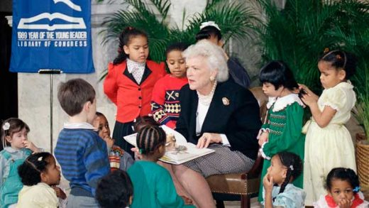 "FILE - In this March 7, 1989, file photo, first lady Barbara Bush reads to a group of day care students at the Library of Congress in Washington celebrating ""1989-Year of the Young Reader."" In March 1989, JUST weeks after moving into the White House, Mrs. Bush founded the Barbara Bush Foundation for Family Literacy. It has since raised more than $110 million to create or support literacy programs for men, women and children nationwide. She remained active with the group until mere months before her death Tuesday, April 17, 2018 at age 92. (AP Photo/Charles Tasnadi, File)"