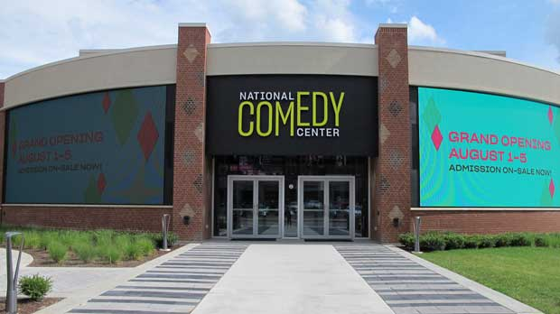 "FILE - This July 24, 2018, file photo shows the main entrance to the National Comedy Center in Jamestown, N.Y. The center is open for laughs in ""I Love Lucy"" comedian Lucille Ball's hometown. Amy Schumer, Lewis Black and Dan Aykroyd are among comedians set to appear during this week's grand opening celebration. (AP Photo/Carolyn Thompson, File)"