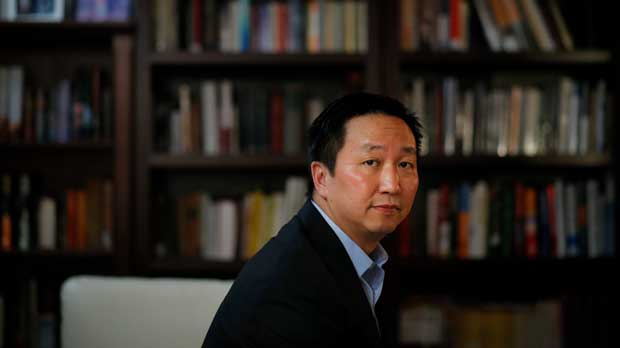 In this July 20, 2018, photo, Chinese-American lawyer Lee Cheng poses for photos in Santa Ana, Calif. Cheng sued the San Francisco Unified School District in 1994 to overturn its cap on Chinese students at Lowell High School. (AP Photo/Jae C. Hong)