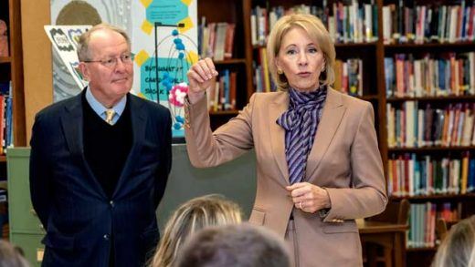 Sen. Lamar Alexander listens as Department of Education Secretary Betsy DeVos speaks to students at Sevier County High School, Tuesday, Nov. 13, 2018, in Sevierville, Tenn. The pair spoke about the newly launched myStudentAid mobile application. (Robert Berlin/The Daily Times via AP)