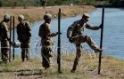 Migrants Won't See Armed Soldiers on Border