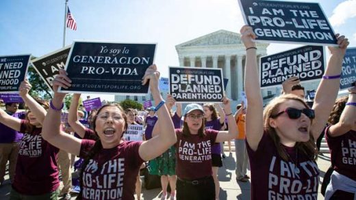 FILE - In this June 25, 2018 file photo, pro-life and anti-abortion advocates demonstrate in front of the Supreme Court. On Wednesday, Nov. 28, 2018, representatives of several national anti-abortion groups met with administration staffers at the White House to discuss how President Donald Trump _ who has supported their agenda _ could continue to be helpful in the changed political circumstances. (AP Photo/J. Scott Applewhite, File)