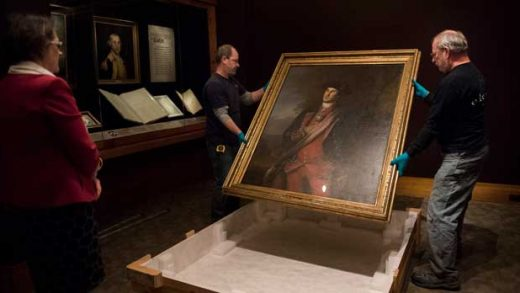 Dermot Rooney, left, and David Schlaegel prepare to install George Washington's Peale portrait, on loan from Washington & Lee University, in the Donald W. Reynolds Museum at Mount Vernon on Thursday, Dec. 13, 2018 in Mount Vernon, Va. (AP Photo/Kevin Wolf)