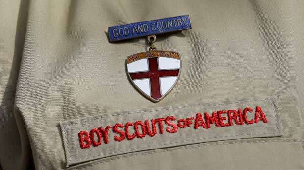 """FILE - In this Feb. 4, 2013 file photo, shows a close up detail of a Boy Scout uniform worn during a news conference in front of the Boy Scouts of America headquarters in Irving, Texas. The Boy Scouts of America says it is exploring """"all options"""" to address serious financial challenges, but is declining to confirm or deny a report that it may seek bankruptcy protection in the face of declining membership and sex-abuse litigation. """"I want to assure you that our daily mission will continue and that there are no imminent actions or immediate decisions expected,"""" Chief Scout Executive Mike Surbaugh said in a statement issued Wednesday, Dec. 12, 2018. (AP Photo/Tony Gutierrez, File)"""