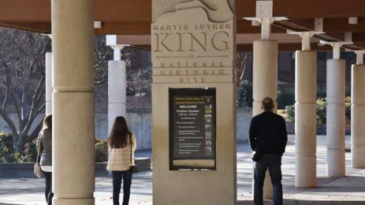 FILE - In this Dec. 22, 2018 file photo, visitors walk around the Martin Luther King, Jr. National Historical Park in Atlanta. The national landmark honoring slain civil rights leader is closed due to the partial government shutdown, but will reopen in time for the King holiday with some corporate help. Delta Air Lines announced Friday, Jan. 18, 2019 that the Martin Luther King Jr. National Historical Park in Atlanta will reopen Saturday, in time for Monday's Martin Luther King Jr. Day. (Hyosub Shin/Atlanta Journal-Constitution via AP, File)
