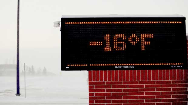 Moorhead, MN area elementary school electronic sign shows to temperature Tuesday, Jan. 29, 2019. Daytime temperatures in the Fargo-Moorhead area were near -20F as frigid weather grips the area. (AP Photo/Bruce Crummy)