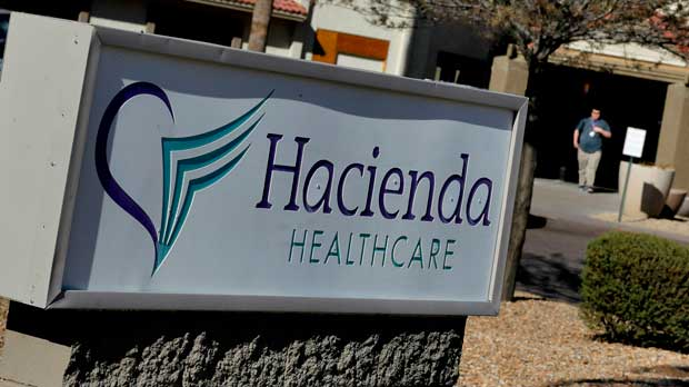 FILE - This Jan. 25, 2019 file photo shows the Hacienda HealthCare facility in Phoenix. A month after an incapacitated woman gave birth at a Phoenix long-term care facility, a panel is calling on Arizona lawmakers and agencies to make policy changes to protect vulnerable adults from sexual abuse. (AP Photo/Matt York)