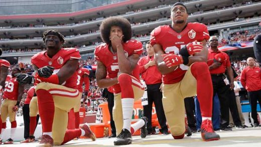 FILE - In this Oct. 2, 2016, file photo, from left, San Francisco 49ers outside linebacker Eli Harold, quarterback Colin Kaepernick and safety Eric Reid kneel during the national anthem before an NFL football game against the Dallas Cowboys in Santa Clara, Calif. There's an exhibit at the High Museum in Atlanta, not far from the Super Bowl stadium, dedicated to Tommie Smith and his courageous stand for social justice at the 1968 Olympics. Talk about symmetry. Smith raised a fist, Colin Kaepernick took a knee, and both paid an enormous price for doing the right thing. (AP Photo/Marcio Jose Sanchez, File)