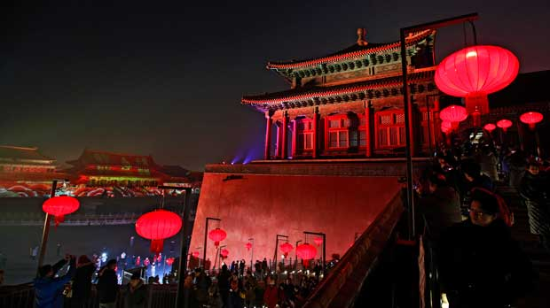Visitors tour the Forbidden City decorated with red lanterns and illuminated with lights during the Lantern Festival in Beijing, Tuesday, Feb. 19, 2019. Beijing's Palace Museum was illuminated and opened for night visits to celebrate China's Lantern Festival. For the first time since it was established 94 years ago, the Palace Museum, also known as the Forbidden City, extended opening hours till nighttime and lit up part of its cultural relics buildings. (AP Photo/Andy Wong)