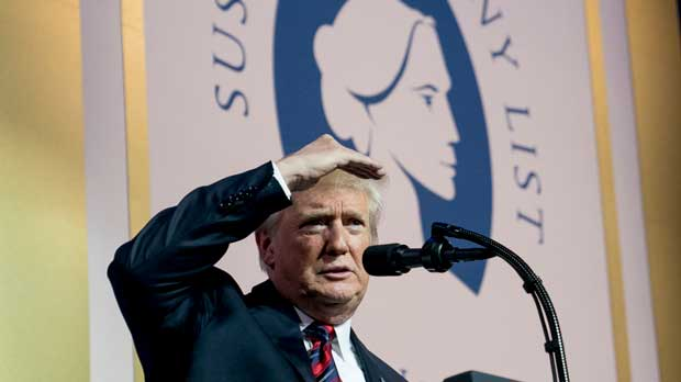 FILE - In this May 22, 2018 file photo, President Donald Trump looks out at the audience during a speech at the Susan B. Anthony List 11th Annual Campaign for Life Gala at the National Building Museum in Washington. The Trump administration said Friday that it would bar taxpayer-funded family planning clinics from referring women for abortions, a move certain to be challenged in court by abortion rights supporters. (AP Photo/Andrew Harnik)