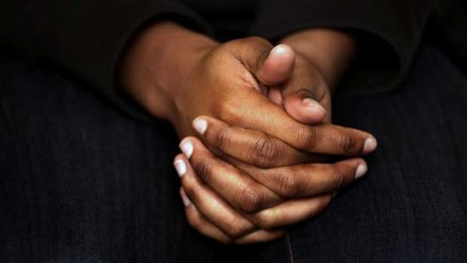 A survivor of sexual assault holds her hands as she speaks during an interview in the Brooklyn borough of New York on Wednesday, March 6, 2019. Various studies have found that 7 in 10 girls endure some form of sexual harassment by age 18, and 1 in 4 will be sexually abused. Experts believe the rates are higher for girls of color. (AP Photo/Wong Maye-E)