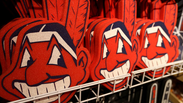FILE - In this Jan. 29, 2018 file photo, foam images of the MLB baseball Cleveland Indians' mascot Chief Wahoo are displayed for sale at the Indians' team shop in Cleveland. The Chief Wahoo logo is being removed from the Cleveland Indians' uniform in the 2019 season, but the Club will still sell merchandise featuring the mascot in Northeast Ohio. The U.S. has spent most of 2019 coming to grips with blackface and racist imagery, but Native Americans say they don't see significant pressure applied to those who perpetuate Native American stereotypes. (AP Photo/Tony Dejak, File)