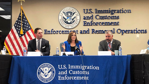 U.S. Sen. Martha McSally, joined by Tim Roemer from Gov. Doug Ducey's office, left, and Henry Lucero, ICE's Enforcement and Removal Operations field director for Phoenix, speaks during a discussion with several non-profit groups and with immigration officials in Phoenix Monday, April 1, 2019. They discussed local response to a spike in the number of immigrant families who are coming to the U.S. and being released in Arizona cities like Phoenix, Yuma and Tucson. (AP Photo/Astrid Galvan)
