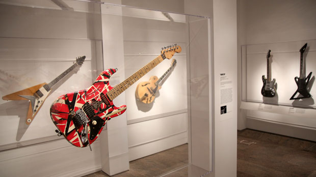 """Electric guitars are displayed at the exhibit """"Play It Loud: Instruments of Rock & Roll"""" at the Metropolitan Museum of Art in New York, Monday, April 1, 2019. The exhibit, which showcases the instruments of rock and roll legends, opens to the public on April 8 and runs until Oct. 1, 2019. (AP Photo/Seth Wenig)"""
