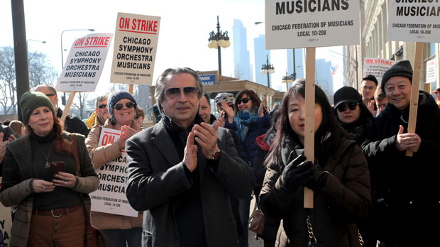 FILE - In this March 12, 2019, file photo, Chicago Symphony Orchestra conductor Riccardo Muti joins in solidarity with striking CSO musicians during a press conference outside the orchestra building in Chicago. The Chicago Federation of Musicians, which represents the striking CSO musicians, is returning to the bargaining table with orchestra officials, the union said in a statement Wednesday, April 3, 2019. About 100 of the orchestra's musicians have been on strike since March 11 over wages and retirement benefits. (Antonio Perez/Chicago Tribune via AP, File)