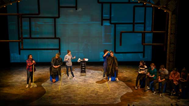 """In this March 30, 2019 photo, The University of Michigan's School of Music, Theater and Dance perform """"Flint"""" during a technical rehearsal at the Arthur Miller Theater in Ann Arbor, Mich. The new play at U of M tells the story of the Flint water crisis through the voices of residents, activists, scientists and politicians. It will premiere on Thursday, April 4, 2019, and run for two weeks. (Roger Hart/UM Photography via AP)"""