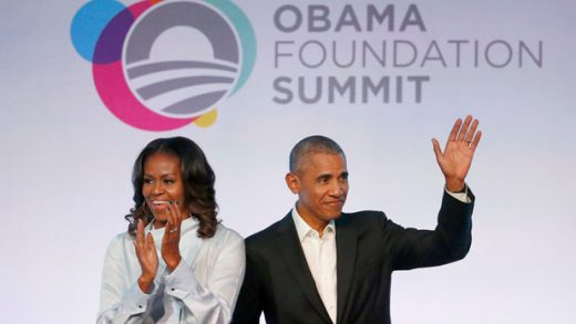 FILE - In this Oct. 31, 2017, file photo, former President Barack Obama, right, and former first lady Michelle Obama arrive for the first session of the Obama Foundation Summit in Chicago. Obama's foundation collected contributions of more than $1 million from 11 firms and individuals in the first three months of 2019, records show. The Obama Foundation's donor list, which is updated quarterly, included the AT&T Foundation and the W.K. Kellogg Foundation on Monday, along with other family trusts and foundations. The list also included foreign investors like Malaysian businessman Tony Fernandes, who is chief executive of AirAsia, and Rumi Verjee, who is a member of the British House of Lords. (AP Photo/Charles Rex Arbogast, File)