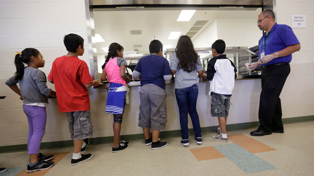 "FILE - In this Sept. 10, 2014, file photo, detained immigrant children line up in the cafeteria at the Karnes County Residential Center, a detention center for immigrant families, in Karnes City, Texas. The Trump administration stopped using the center to hold parents and children in March 2019. It's cut back on family detention even as it complains it has to ""catch and release"" migrant families, many of them Central American parents and children who seek asylum. (AP Photo/Eric Gay, File)"