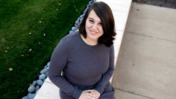 """FILE - In this Wednesday, Nov. 4, 2015 file photo, Miranda Taylor, 20, poses for a portrait outside Christ College of Nursing and Health Science in Cincinnati. When she was 16 and weighed 265 pounds, she had obesity surgery. Taylor lost more than 100 pounds, along with severe depression, pre-diabetes and an obesity-related hormonal condition. """"I feel awesome. It's like a new life,"""" she says. (AP Photo/Michael Conroy)"""