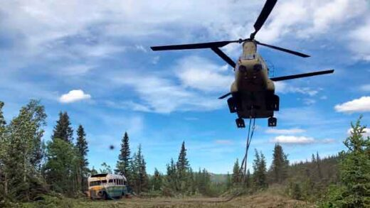 soldiers use a CH-47 Chinook helicopter to removed an abandoned bus