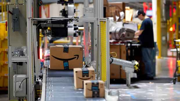 packages pass through a scanner at an Amazon fulfillment center in Baltimore