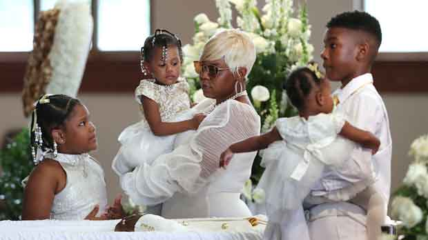 Tomika Miller, wife of Rayshard Brooks, holds their 2-year-old daughter Memory